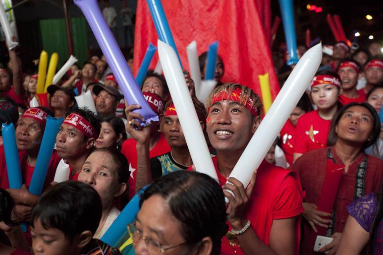 Supporters of Myanmar opposition leader Aung San Suu Kyi's National League for Democracy party cheer as they watch the results of the general election on an LED screen displayed outside the party's headquarters. AP Photo