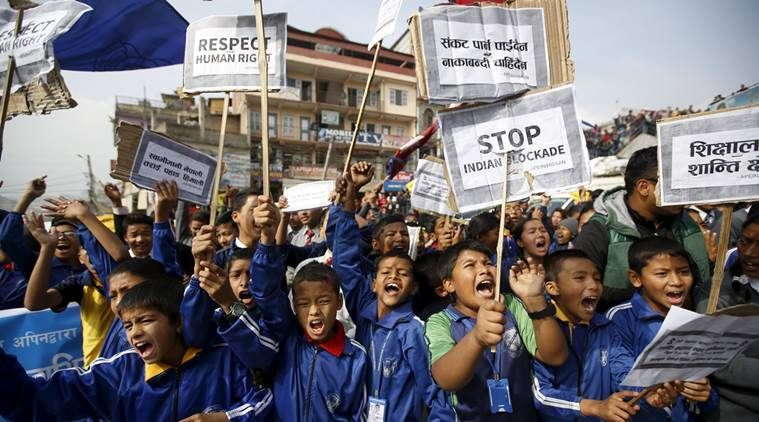 Nepalese students holding placards take part in a protest to show solidarity against the border blockade in Kathmandu, Nepal November 27, 2015. The middle hills and the capital Kathmandu have suffered fuel and cooking gas shortages after protesters in the south switched to blocking supplies from India, Nepal's largest trading partner, almost two months ago. Many in Nepal accuse India of supporting the protesters - a charge New Delhi denies. India has expressed its dissatisfaction with parts of the constitution, although it also says it cannot allow trucks to enter Nepal while conditions are unsafe. REUTERS/Navesh Chitrakar