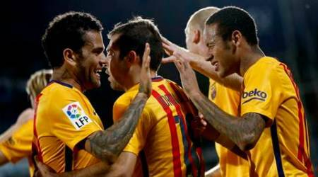 Barcelona's Neymar, right, celebrates after scoring a goal during a Spanish La Liga soccer match between Barcelona and Getafe at the Coliseum Alfonso Perez stadium in Getafe, Spain,  Saturday, Oct. 31, 2015. (AP Photo/Daniel Ochoa de Olza)