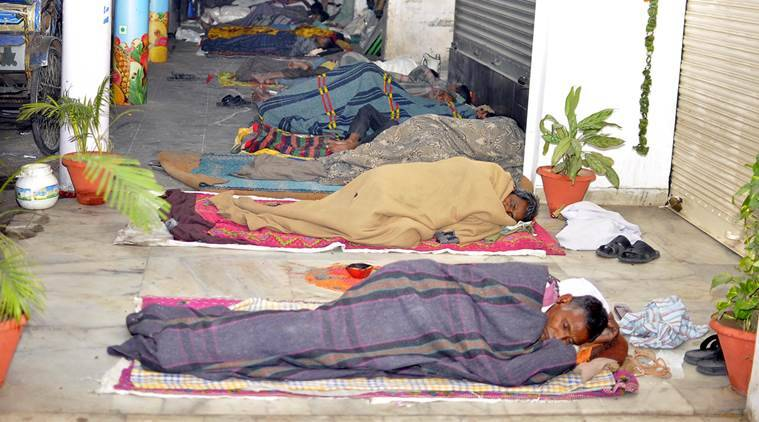 Beggars and Rickshaw pullers sleeping in fronts of Shops in Sector 23 Chandigarh on Saturday, November 14 2015. Express Photo by Sahil Walia