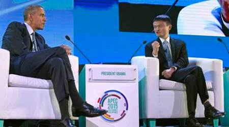 U.S. President Barack Obama, left, listens as Alibaba founder Jack Ma, right, speaks during a discussion at the CEO Summit, attended by 800 business leaders from around the region representing U.S. and Asia-Pacific companies, in Manila, Philippines, Wednesday, Nov. 18, 2015, ahead of the start of the Asia-Pacific Economic Cooperation summit. (AP Photo/Susan Walsh)