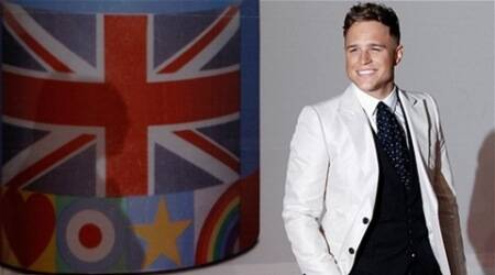 Keeping myself busy to move on from break-up: Olly Murs