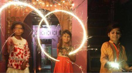 Pakistani children from Hindu community celebrate the Diwali in Karachi, Pakistan, Wednesday, Nov. 11, 2015. Diwali, the festival of lights, is one of Hinduism's most important festivals dedicated to the worship of Lakshmi, the Hindu goddess of wealth. (AP Photo/Fareed Khan)