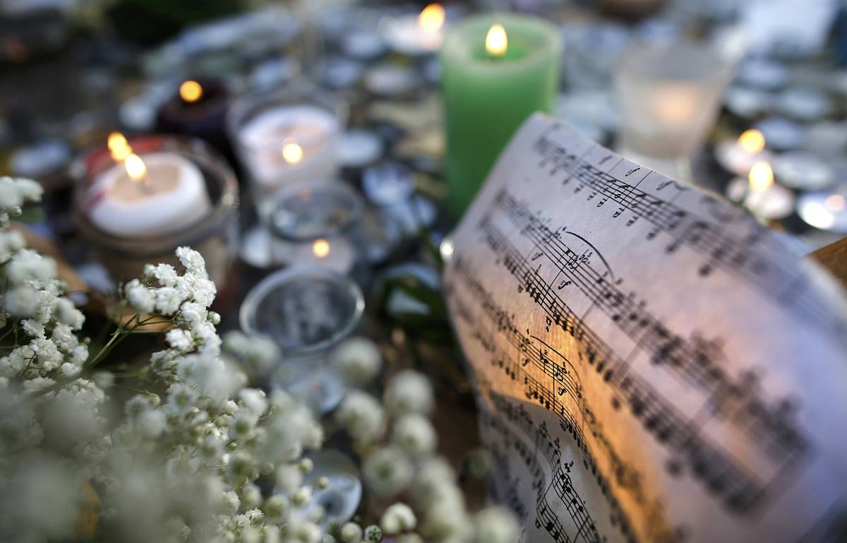 Sheet music is seen amongst candles near the site of the attack at the Bataclan concert hall in Paris. Reuters