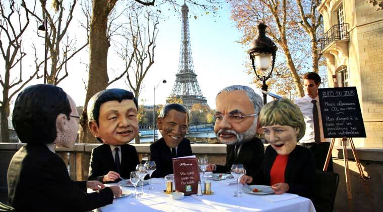 Activists wear masks depicting world leaders, including Prime Minister Narendra Modi, in Paris on Saturday. (AP Photo)