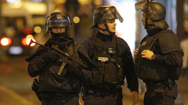 French police raiding a neighbourhood in Saint Denis, northern Paris. (Source: AP)