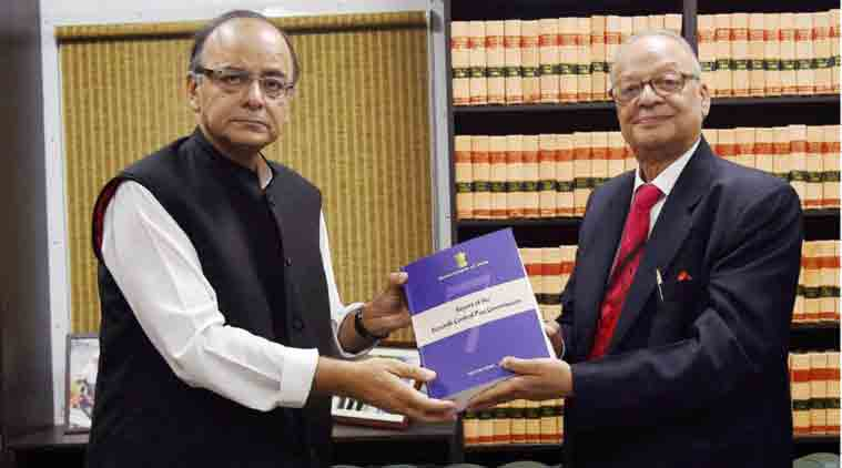Finance Minister Arun Jaitley receives the pay panel report from Justice A K Mathur in New Delhi on Thursday. PTI