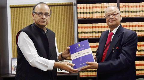New Delhi: Finance Minister Arun Jaitley receiving the report of Seventh Pay Commission from its Chairman Justice A K Mathur in New Delhi on Thursday. PTI Photo by Atul Yadav (PTI11_19_2015_000342A)