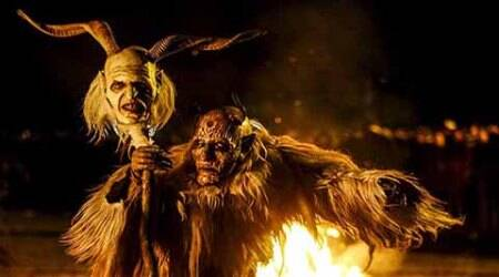 A man dressed in a traditional Perchten costume and mask performs during a Perchten festival in the western Austrian village of Kappl, November 13, 2015. Each year in November and January, people in the western Austria regions dress up in Perchten (also known in some regions as Krampus or Tuifl) costumes and parade through the streets to perform a 1,500 year-old pagan ritual to disperse the ghosts of winter. REUTERS/Dominic Ebenbichler