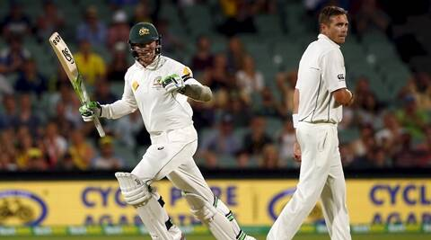 Australia's Peter Siddle (L) celebrates as he runs past New Zealand's Tim Southee after he hit the winning runs during the third day of the third cricket test match at the Adelaide Oval, in South Australia, November 29, 2015.    REUTERS/David Gray
