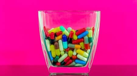 Colorful pills in a large bowl