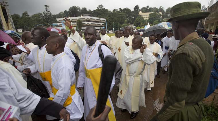 A Kenyan soldier directs Catholic priests as they queue after dawn to attend a Holy Mass to be given by Pope Francis at the campus of the University of Nairobi in Kenya. (Source: AP)