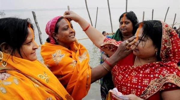 Women celebrate Chhath Puja in Patna. (Source: PTI photo)