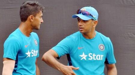 Kolkata: Former Indian Cricketer and Coach of India U-19 team Rahul Dravid interacts with a player during the practice session ahead of tri-nation series against Bangladesh and Afghanistan, at Salt Lake City in Kolkata on Tuesday. PTI Photo (PTI11_17_2015_000096A)