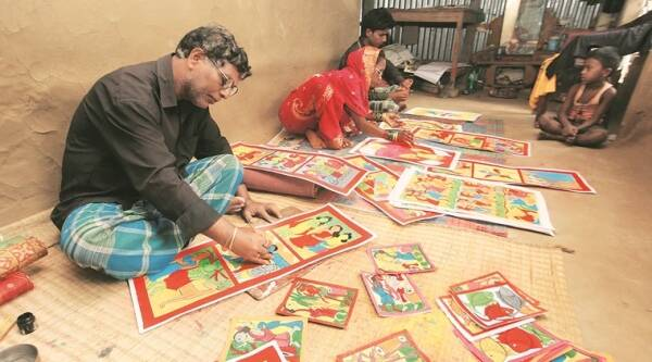 Yakub Chitrakar painting scroll along with his family members at his home at Noya in West Midnapore. (Source: Express photo by Subham Dutta)