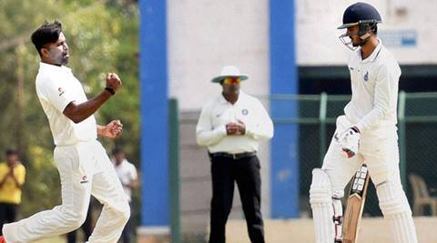 Hubli: Karnataka players celebrates dismissal of Nitesh Rana during the Karnataka vs Delhi, Ranji Trophy match in Hubli on Wednesday. PTI Photo(PTI11_25_2015_000134B)
