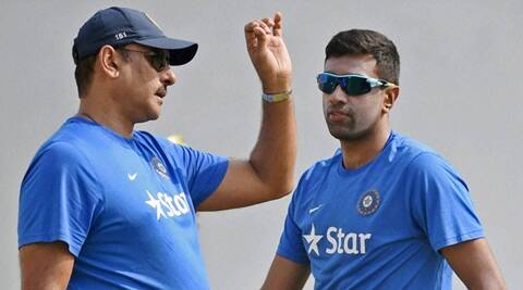 Nagpur: Cricketer R Ashwin along with the team director Ravi Shastri  during a practice session ahead of the test match against South Africa in Nagpur on Tuesday. PTI Photo by Shashank Parade (PTI11_24_2015_000044B)