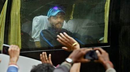 Bengaluru: People waving towards cricketer Ravindra Jadeja sitting in the bus as players leave the stadium after the second day of the match got cancelled due to rain during the second test match between India and South Africa at Chinnaswamy Stadium in Bengaluru on Sunday. PTI Photo by Shailendra Bhojak(PTI11_15_2015_000128B)