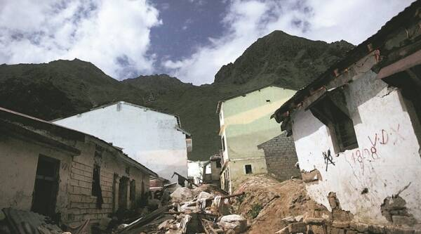 Broken houses lead to the temple. (Source: Express photo by Oinam Anand)