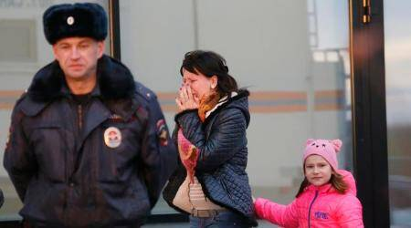 A relative of those on the Metrojet flight that crashed in Egypt react as they gather to grieve at a hotel near St. Petersburg's Pulkovo airport outside St.Petersburg, Russia, Saturday, Oct. 31, 2015. Russia's civil air agency is expected to have a news conference shortly to talk about the Russian Metrojet passenger plane that Egyptian authorities say has crashed in Egypt's Sinai peninsula. (AP Photo/Dmitry Lovetsky)