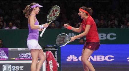 Singapore  :Martina Hingis of Switzerland, left, and Sania Mirza of India celebrate beating Taiwanese sisters Chan Hao Ching and Chan Yung Jan of Taiwan during the doubles semifinal at the WTA tennis finals in Singapore on Saturday, Oct. 31, 2015. AP/PTI(AP10_31_2015_000060B)