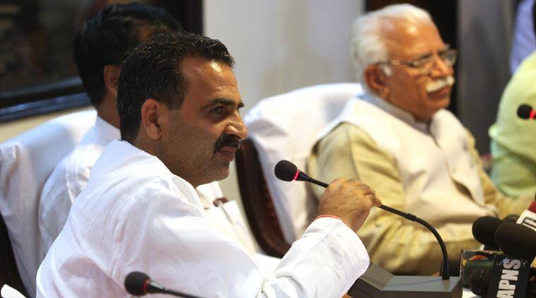 Union Minister of State for Agriculture Dr Sanjeev Kumar Balyan with Haryana Chief Minister Manohar Lal during press conference at Haryana Niwas on damaged crops in Haryana, in Chandigarh on Tuesday, March 31 2015. Express photo by Jaipal Singh