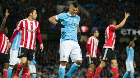 Manchester City's Sergio Aguero, centre, winces as he appears to be hurt shortly before being substituted during the English Premier League soccer match between Manchester City and Southampton at the Etihad Stadium, Manchester, England, Saturday Nov. 28, 2015. (AP Photo/Jon Super)
