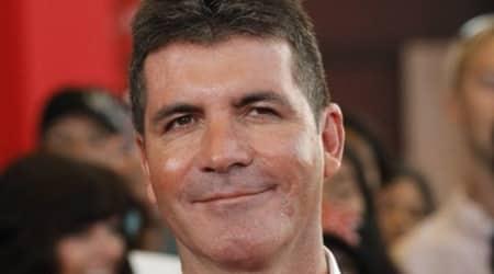 Simon Cowell, Simon Cowell son, Simon Cowell father, Simon Cowell son Eric, Simon Cowell wife, Simon Cowell partner Lauren Silverman, Simon Cowell X Factor, Simon Cowell judge, Simon Cowell talent show, Simon Cowell television producer, Entertainment News