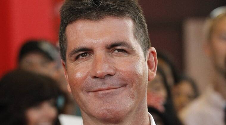 Simon Cowell, Simon Cowell son, Simon Cowell father, Simon Cowell son Eric, Simon Cowell wife, Simon Cowell partner Lauren Silverman, Simon Cowell X Factor, Simon Cowell judge, Simon Cowell talent show, Simon Cowell television producer, Entertainment News