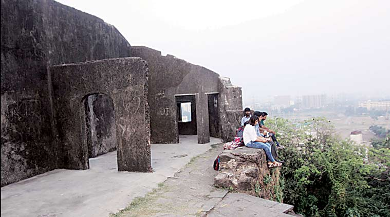 The walls of the Sion Fort, standing on a 10-acre plot in Central Mumbai, are battered, covered in fading graffitti and  love messages by couples etched on the  stone. (Express Photo by Pradip Das)