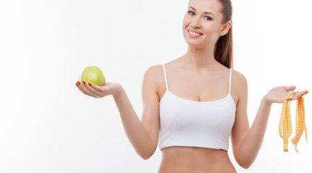 Attractive young fit girl is dieting successfully