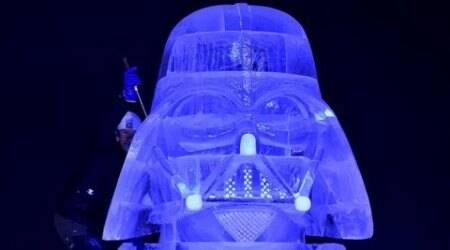 REFILE - CORRECTING SPELLING OF CHARACTER NAMEHungary's Zsolt Toth carves Star Wars character Darth Vader for the ice sculpture festival in Liege, Belgium, November 13, 2015. REUTERS/Eric Vidal  EDITORIAL USE ONLY. NO RESALES. NO ARCHIVE