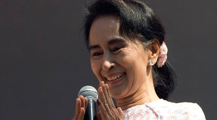 Leader of Myanmar's opposition National League for Democracy party, Aung San Suu Kyi, with ink still imprinted on the little finger of her left hand after voting Sunday, delivers a speech from a balcony of the NLD headquarters in Yangon, Myanmar, Monday, Nov. 9, 2015. Suu Kyi on Monday hinted at a victory by her party in the country's historic elections, and urged supporters not to provoke their losing rivals who are backed by the military.(AP Photo/Mark Baker)