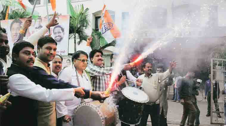 Congress workers celebrate in Bhopal on Tuesday. (Source: PTI)