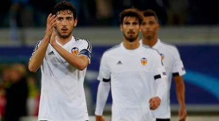 (L-R) Valencia's Daniel Parejo, Andre Gomes and Santos react after their Champions League Group H soccer match against Gent at Ghelamco Arena in Ghent, Belgium, November 4, 2015. REUTERS/Yves Herman