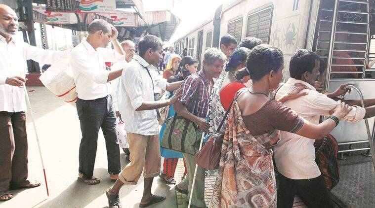 Residents of the village climb on a local train to Mumbai to hawk their wares (Source: Pavan Khengre)