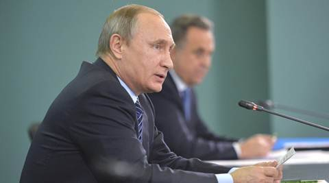 Russian President Vladimir Putin (front) and Sports Minister Vitaly Mutko attend a meeting, dedicated to the preparations of Russian athletes for the 2016 Olympics in Brazil, in Sochi, Russia, November 11, 2015. Putin said on Wednesday Russia needed to conduct its own investigation into allegations its athletes had systematically taken performance-enhancing substances and that someone needed to take personal responsibility for the problem. REUTERS/Aleksey Druzhinin/RIA Novosti/Kremlin ATTENTION EDITORS - THIS IMAGE HAS BEEN SUPPLIED BY A THIRD PARTY. IT IS DISTRIBUTED, EXACTLY AS RECEIVED BY REUTERS, AS A SERVICE TO CLIENTS.