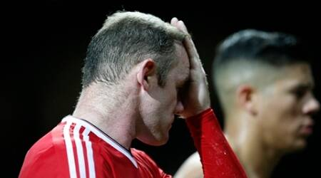 Manchester United's Wayne Rooney reacts after the Champions League group B soccer match between Manchester United and PSV Eindhoven at Old Trafford Stadium in Manchester, England, Wednesday, Nov. 25, 2015. The match ended 0-0. (AP Photo/Jon Super)