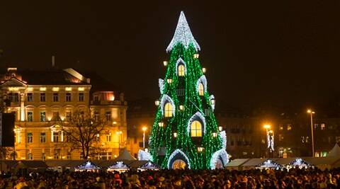 The National Christmas tree during a lighting ceremony at Cathedral square in Vilnius, Lithuania, Friday, Nov. 27, 2015. (AP Photo/Mindaugas Kulbis)