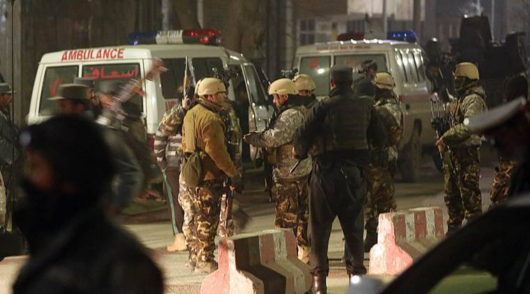 Afghan security forces stand guard near a terrorist attack site, close to the Spanish embassy, in the center of Kabul, Afghanistan, Friday, Dec. 11, 2015. An Afghan official says a car bombing near a foreign guesthouse in central Kabul has wounded one person. (AP Photos/Massoud Hossain)