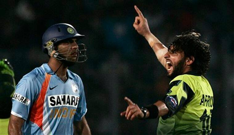 "Shahid Afridi (right) celebrates Yuvraj Singh¿s dismissal. AP photo *** Local Caption *** ""Pakistan's Shahid Afridi, right, celebrates the dismissal of India's Yuvraj Singh, left, during their one day international cricket match in Dhaka, Bangladesh, Saturday, June 14, 2008. (AP Photo/Aman Sharma)"""