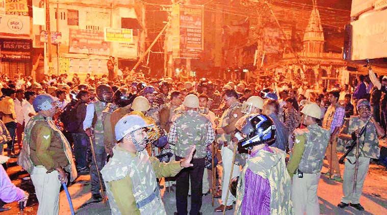Heavy police force deployed in Katra area after alleged Allahabad University students exploded crude bombs and indulged in stone pelting, in Allahabad on Sunday. PTI