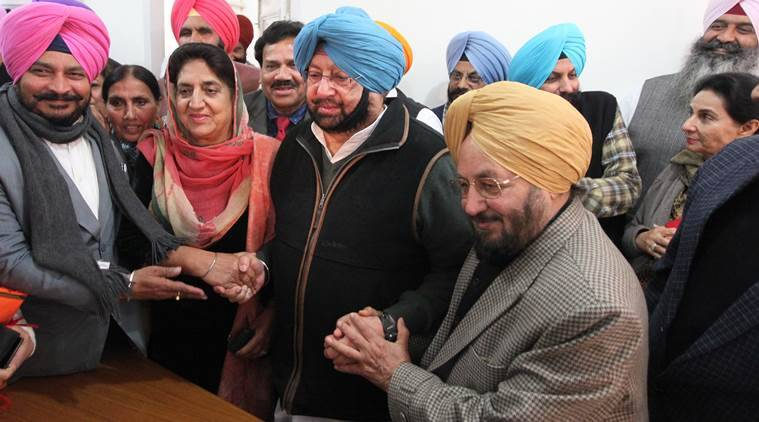 PPCC president Capt. Amarinder Singh alongwith Rajinder Kaur Bhattal, Lal Singh and other Congress MLA's during taking Charge of Office at Punjab Congress Bhawan in Sector 15 of Chandigarh on Thursday, December 17 2015. Express Photo by Kamleshwar Singh
