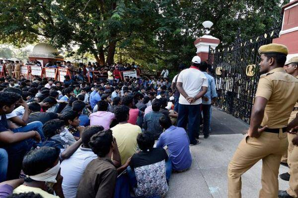 Recently, students of Anna University staged protest in front of their college for postponing of their semester examinations due to floods in Chennai on Sunday. Photo: AP