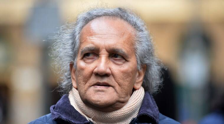 FILE - This is a Nov. 27, 2015 file photo of as he arrives a Maoist cult leader Aravindan Balakrishnan, as he arrives at Southwark Crown Court in London. Balakrishnan has been found guilty of sexually assaulting his female followers and imprisoning his own daughter in a London commune for 30 years. A jury on Friday Dec. 4, 2015 found 75-year-old Aravindan Balakrishnan guilty of four counts of rape and six counts of indecent assault.(Hannah McKay/PA, File via AP) UNITED KINGDOM OUT