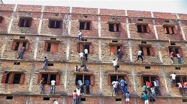The government school in Vaishali district whose photograph showing parents and friends scaling wall of the four-storeyed building like spiders to give chits to the examinees gave a bad name to the state