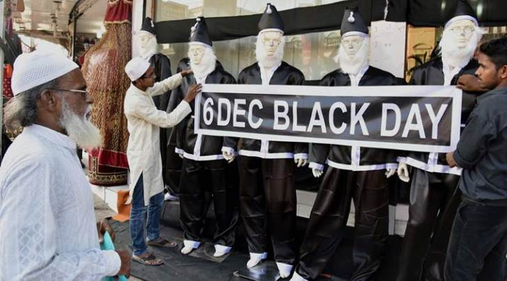 Hyderabad : A shopkeeper dressing up mannequins in black to observe 6th December as Black Day, on the eve of the 23rd anniversary of demolition of Babri mosque in Hyderabad on Saturday. PTI Photo  (PTI12_5_2015_000184B)