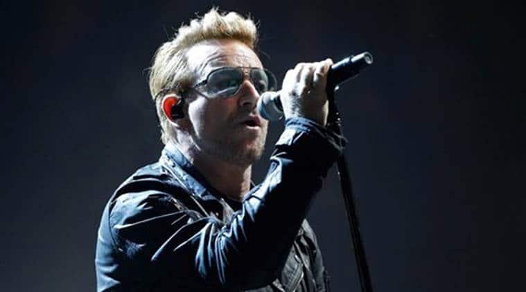 Frontman Bono,Frontman Bono U2,Paris attack,Paris attack victims,Paris attack tribute, French tricolor flag, entertainment news