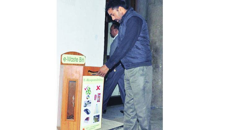 A city resident uses an  e-waste bin at the UT Secretariat in Sector 9, Friday.  Sahil Walia