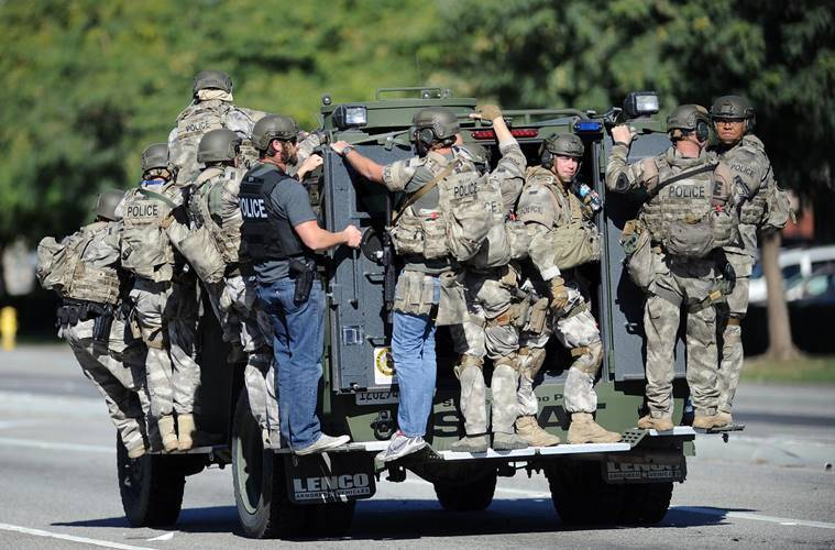 A SWAT vehicle carries police officers near the scene of a shooting in San Bernardino, California. (Micah Escamilla/Los Angeles News Group via AP)